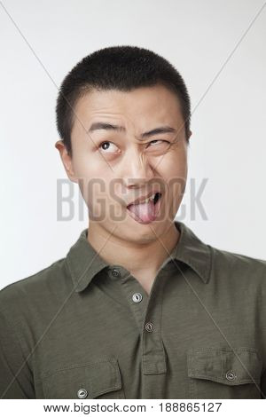 Chinese man making a face