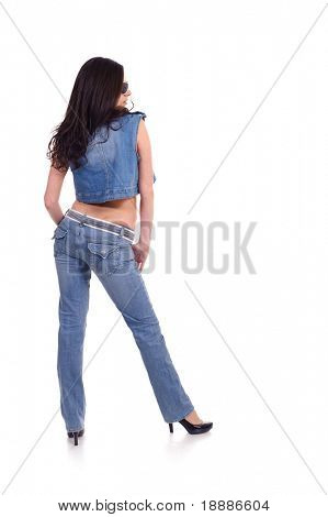 zurück von pretty young Woman posing in Jeans, Bekleidung isolated on white