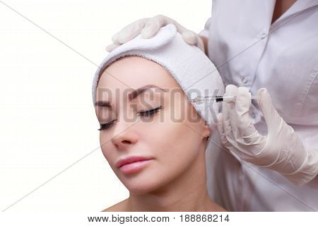 The Doctor Cosmetologist Makes The Botulinotoxin Injection Procedure For Tightening And Smoothing Wr