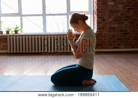 religion, meditation and people concept - close up of woman meditating at yoga studio or praying