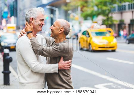 Gay Couple In New York With Traffic On Background