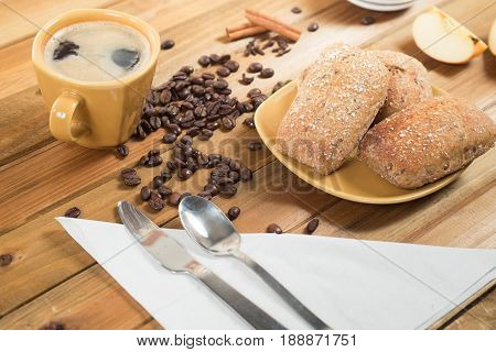 What's your craving for breakfast today. Crispy multi-grain rolls with butter and apple jelly - warm and delicious, with coffee for a drink.