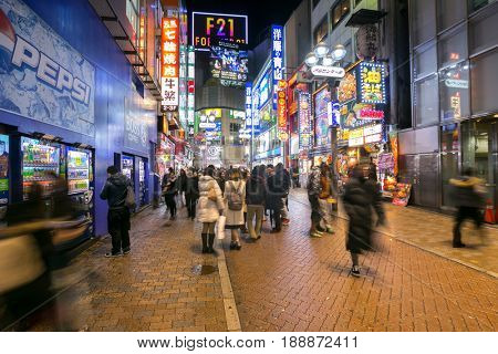 TOKYO - FEB 18: Pedestrians walking at Shibuya on Febuary 18, 2015 in Tokyo, Japan. Shibuya is known as one of the fashion centers of Japan, particularly for young people, and as a nightlife area.