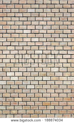 Texture of old vintage light beige brick wall