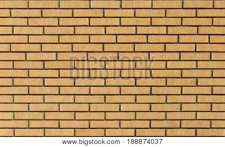 Texture of new yellow brick wall surface