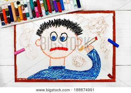 Colorful drawing and crayons: Sad man smoking cigarette