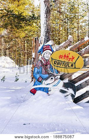 Rovaniemi Finland - March 5 2017: Figure of a man with reindeer at the reindeer farm in winter Rovaniemi Lappish Finland.