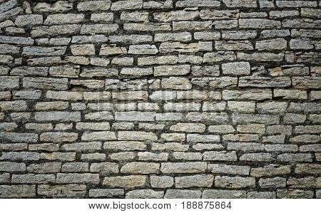 Texture of old cracked gray brick wall