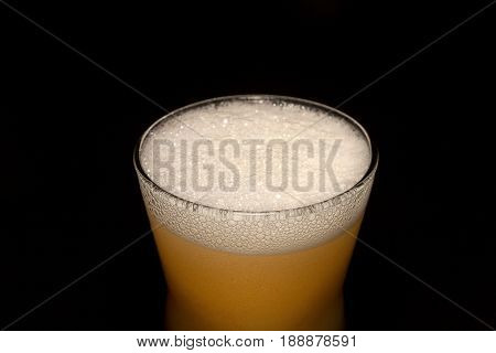 Beer in glass isolated on black background.