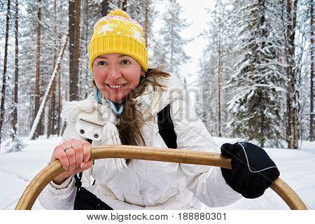 Girl riding Husky dogs sledge in Rovaniemi Lapland Finland