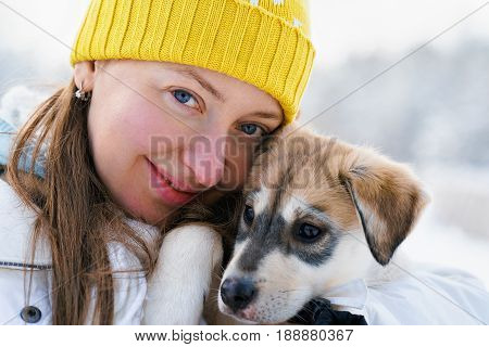 Girl And Husky Puppy In Lapland Finland