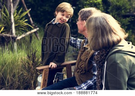Lovely family generations hangout in the nature