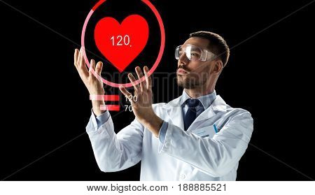 medicine, cardiology and healthcare concept - male doctor or scientist in white coat and safety glasses with heart rate projection over black background