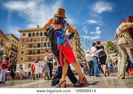 VALENCIA, SPAIN - MAY 28: Unidentified people dance tango in virgin plaza, an event organized by Valencian Tango Club in Valencia on June 28, 2017 in Spain