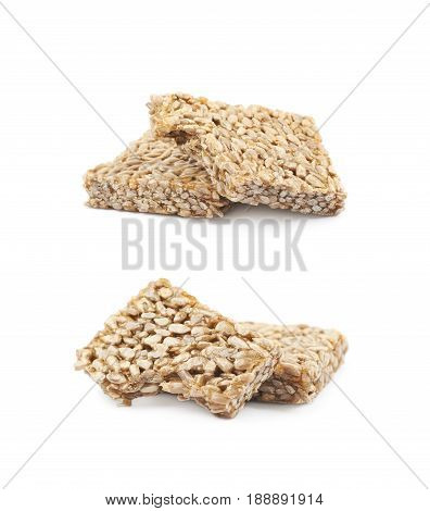 Two pieces of gozinaki confection sweets isolated over the white background, set of two different foreshortenings
