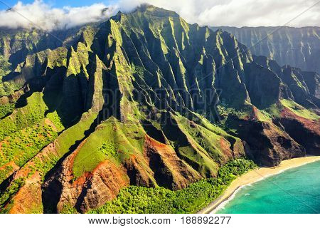 Hawaii nature travel destination. Na Pali coast on Kauai island. Helicopter aerial view of Na Pali Coast mountain landscape in Kauai island, Hawaii, USA.