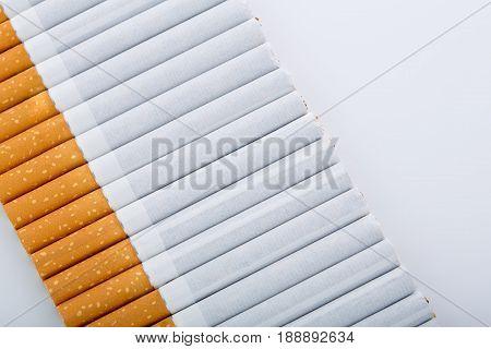 Cigarette Close Up Isolated On White Background. Drug Addiction. Tobacco Smoking. Cancer. Nicotine.