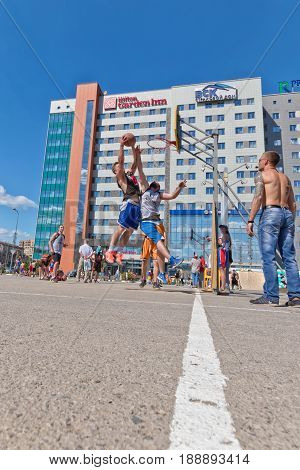VOLGOGRAD - MAY 27: Difficult jump shot with the resistance of the defenders in the open competitions on streetball . May 27, 2017 in Volgograd, Russia.