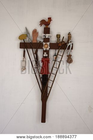 Christian symbols of crucifixion on the wooden cross
