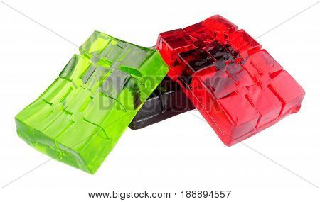 Group of lime and strawberry fruit flavoured jelly slabs isolated on a white background