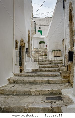 Alleyway With Stairs In Ostuni, Puglia, Italy