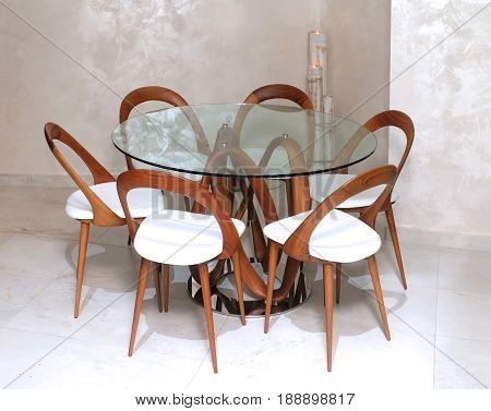 Modern glass dining table with wooden chairs