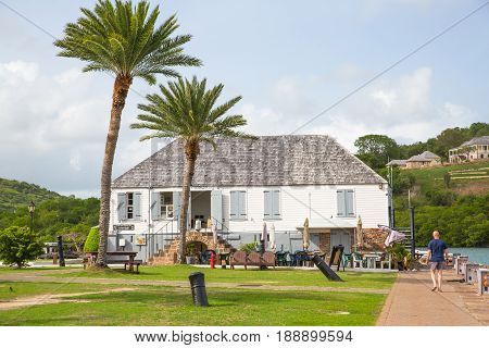 Antigua, Caribbean islands, English Harbour - May 20, 2017: Nelson's Dockyard is a cultural heritage site and marina. Admiral's Inn and storage houses 18th century