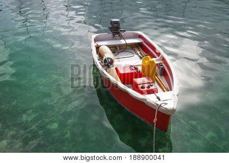 Little motorboat against of sun light reflection. Antigua