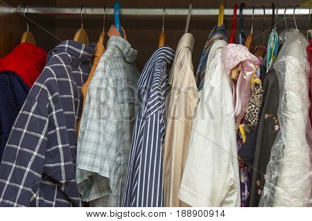 Clothes in the closet Winter clothes on a hanger
