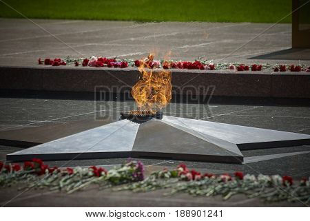 MOSCOW, MAY 9, 2010: Red Square Eternal Light Memorial dedicated to USSR soldiers and people died in Second World WAR WWII. Flame and flowers. USSR victory in Second World War. 9 May Victory day