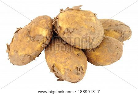 Group of dirty unwashed new potatoes isolated on a white background
