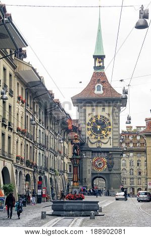 People On The Shopping Alley With The Famous Clocktower Of Bern