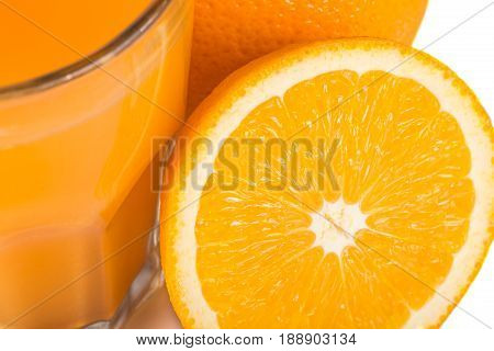 Orange Juice. Isolated Drink. A Glass Of Orange Juice And Pieces Of Orange Fruit Isolated On White B