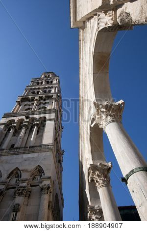 Bell Tower of St Domnius cathedral and Corinthian columns on the Peristyle in Diocletian's palace Split in Croatia