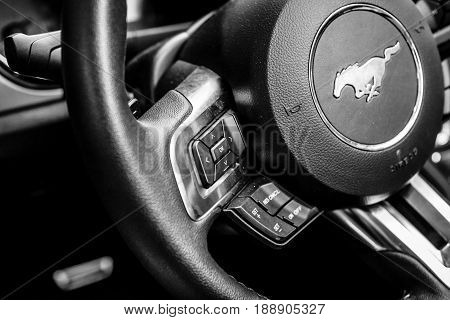 BERLIN - MAY 13 2017: Control buttons for the multimedia system on the steering wheel of the Ford Mustang 5.0 V8 Convertible 2016. Black and white. Exhibition