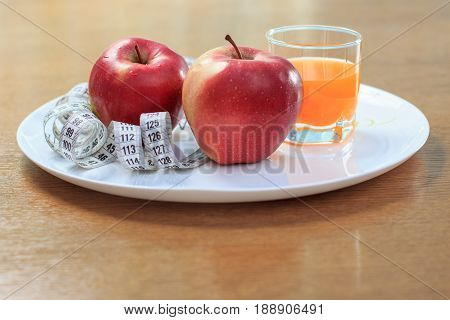 Apples, Ruler On Plate And Multivitamin Juice In Glass
