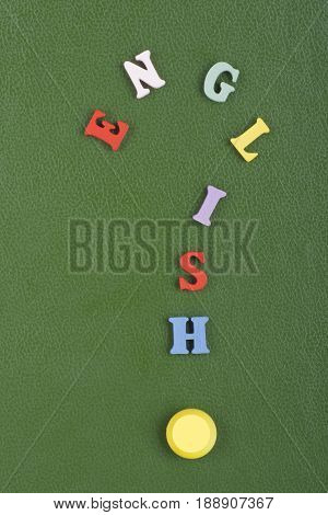 English word on green background composed from colorful abc alphabet block wooden letters, copy space for ad text. Learning english concept