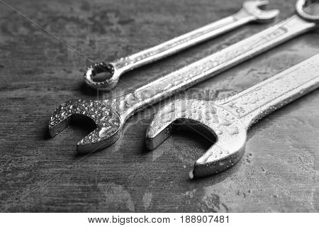 Combination wrenches and spanner on wet table