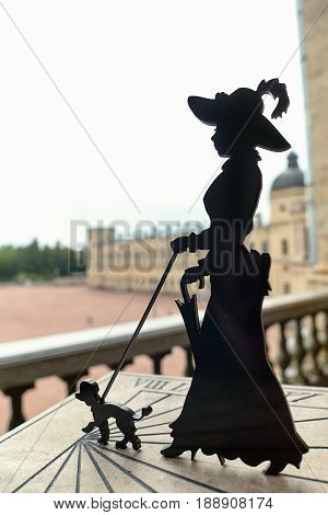 Sundial In the form of a lady with a dog. Installed next to the monument to russian emperor Paul on the parade ground of the Gatchina Palace