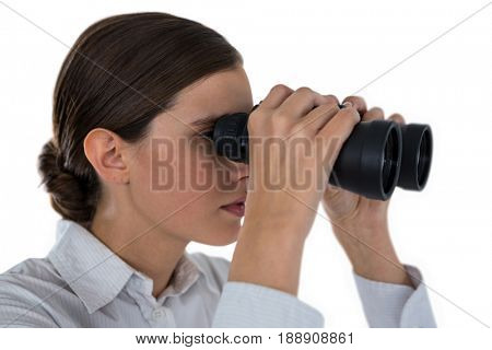Close-up of businesswoman looking through binoculars against a white background