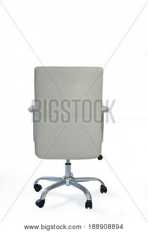 Empty wheeled office chair against white background