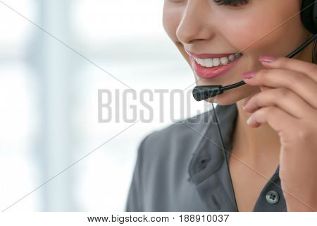 Pretty technical support dispatcher working in office, closeup