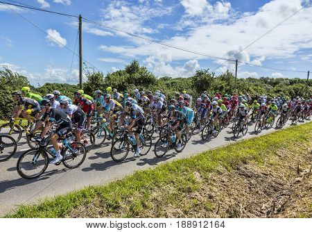QuinevilleFrance- July 2 2016: Chriss Fromme of Team Sky in the peloton riding during the first stage of Tour de France in Quineville France on July 2 2016.