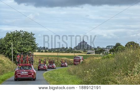 Ardevon France - July 2 2016: The cars of the cycling team Katusha driving to the start of the Tour de France near Mont Saint Michel Monastery in Ardevon France on July 2 2016.