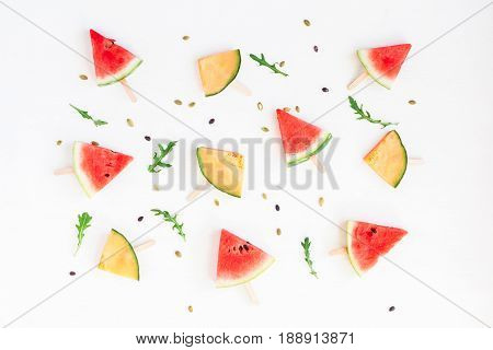 Watermelon popsicle and melon popsicle on white background. Top view flat lay