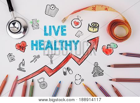 Live healthy concept. Healty lifestyle background. Stethoscope on a white table