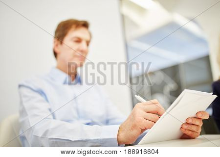 Manager as a business man writes a concept for the strategy plan