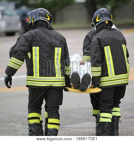 Four Brave Firemen Transport The Injured With A Stretcher
