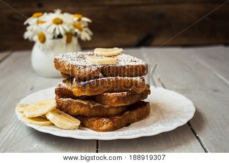 French Toast With Bannana On Wooden Background