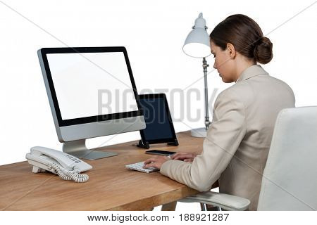 Businesswoman working over computer against white background